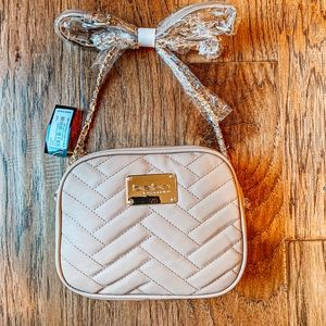 BEBE Ann Subway quilted crossbody taupe bag.
